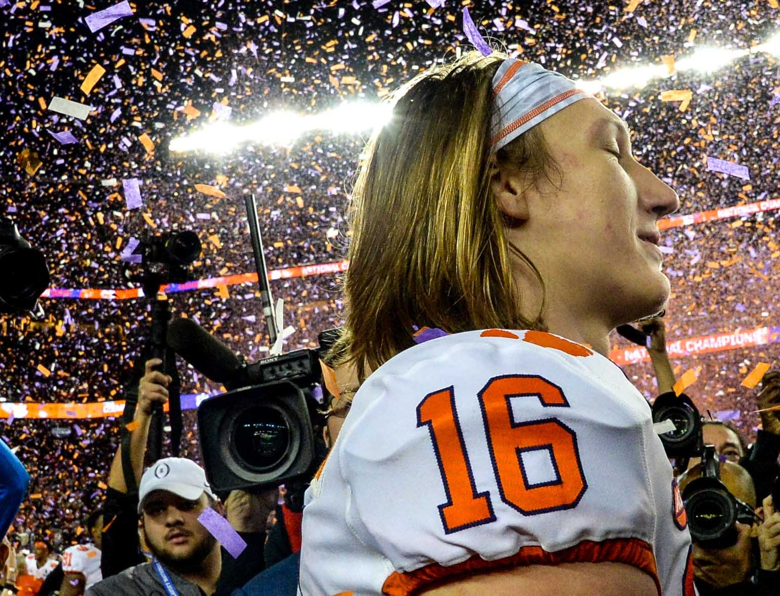 Clemson quarterback Trevor Lawrence (16) celebrates with fans a 44-16 win after the College Football Championship game at Levi's Stadium in Santa Clara, California Monday, January 7, 2019.