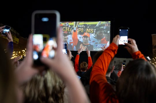 Clemson fans who gathered on College Avenue to watch the game, celebrate Clemson's win in the College Football Playoff National Championship Monday, Jan. 7, 2019.
