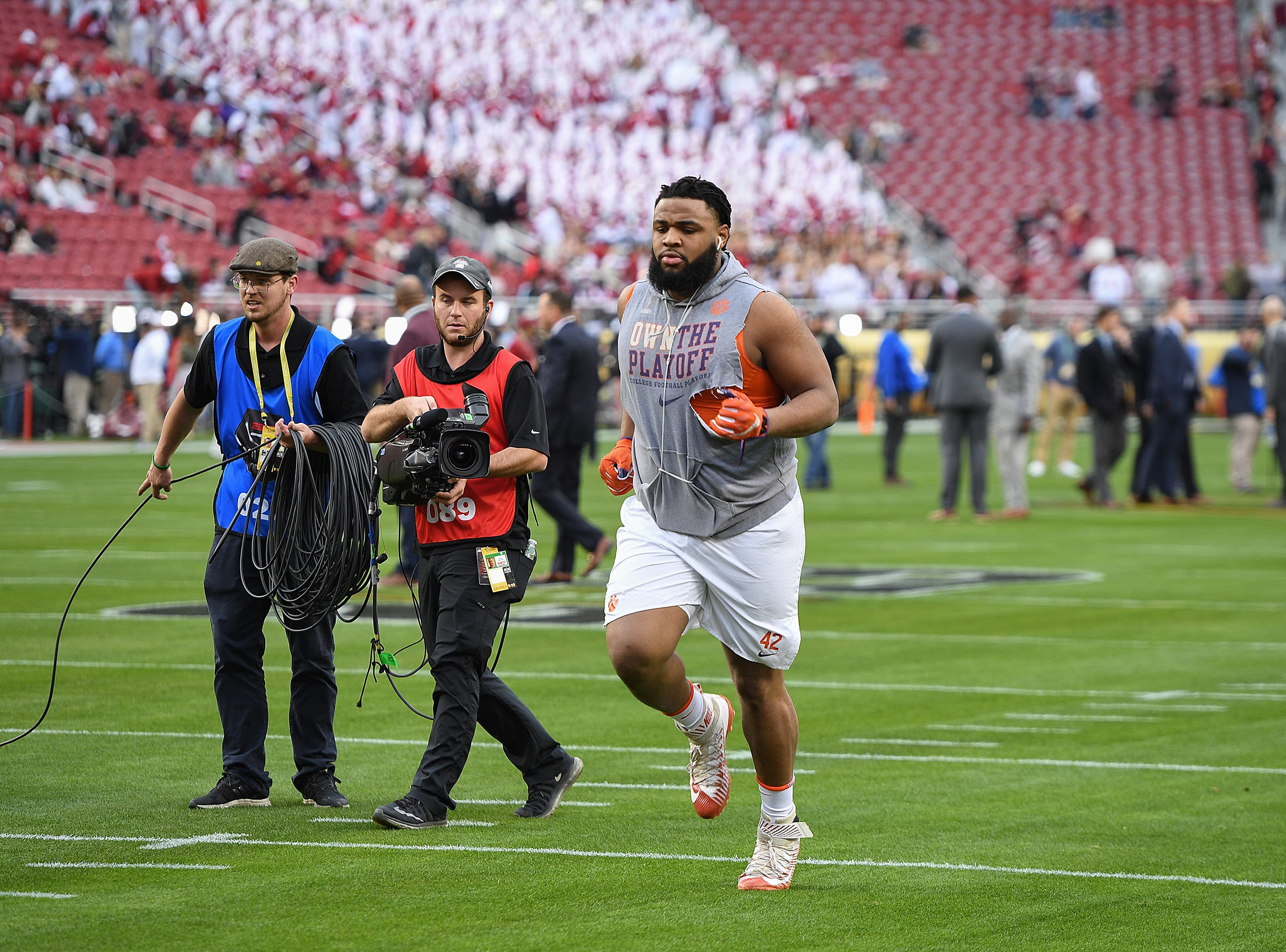 Clemson defensive lineman Christian Wilkins warms up at Levi's Stadium in Santa Clara, CA Monday, January 7, 2019 after the team arrived for their game against Alabama in the College Football National Championship.