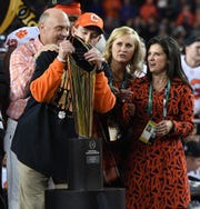 Clemson head coach Dabo Swinney kisses the College Football National Championship trophy after the Tigers defeated Alabama 44-16 at Levi's Stadium in Santa Clara, CA Monday, January 7, 2019.