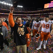 Clemson head coach Dabo Swinney leaves the field with his wife Kathleen after the Tigers defeated Alabama 44-16 in the College Football National Championship game at Levi's Stadium in Santa Clara, CA Monday, January 7, 2019.