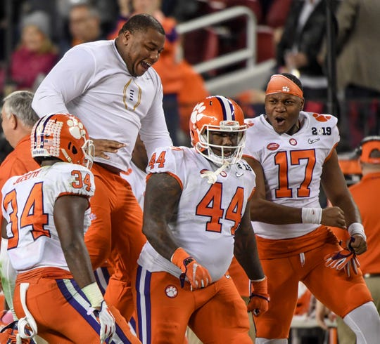 Clemson defensive lineman Dexter Lawrence (90) reacts after Clemson defensive tackle Nyles Pinckney (44) tackled Alabama quarterback Mac Jones (10) on a fake field goal attempt during the third quarter of the College Football Championship at Levi's Stadium in Santa Clara, California Monday, January 7, 2019.
