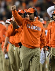 Clemson head coach Dabo Swinney coaches against Alabama during the 2nd half of the College Football National Championship at Levi's Stadium in Santa Clara, CA Monday, January 7, 2019.