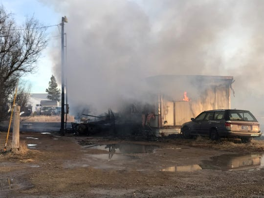 At 4 p.m., flames still appeared in the trailer house.
