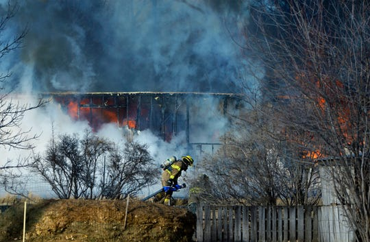 Firefighters respond to a burning trailer home in Great Falls.