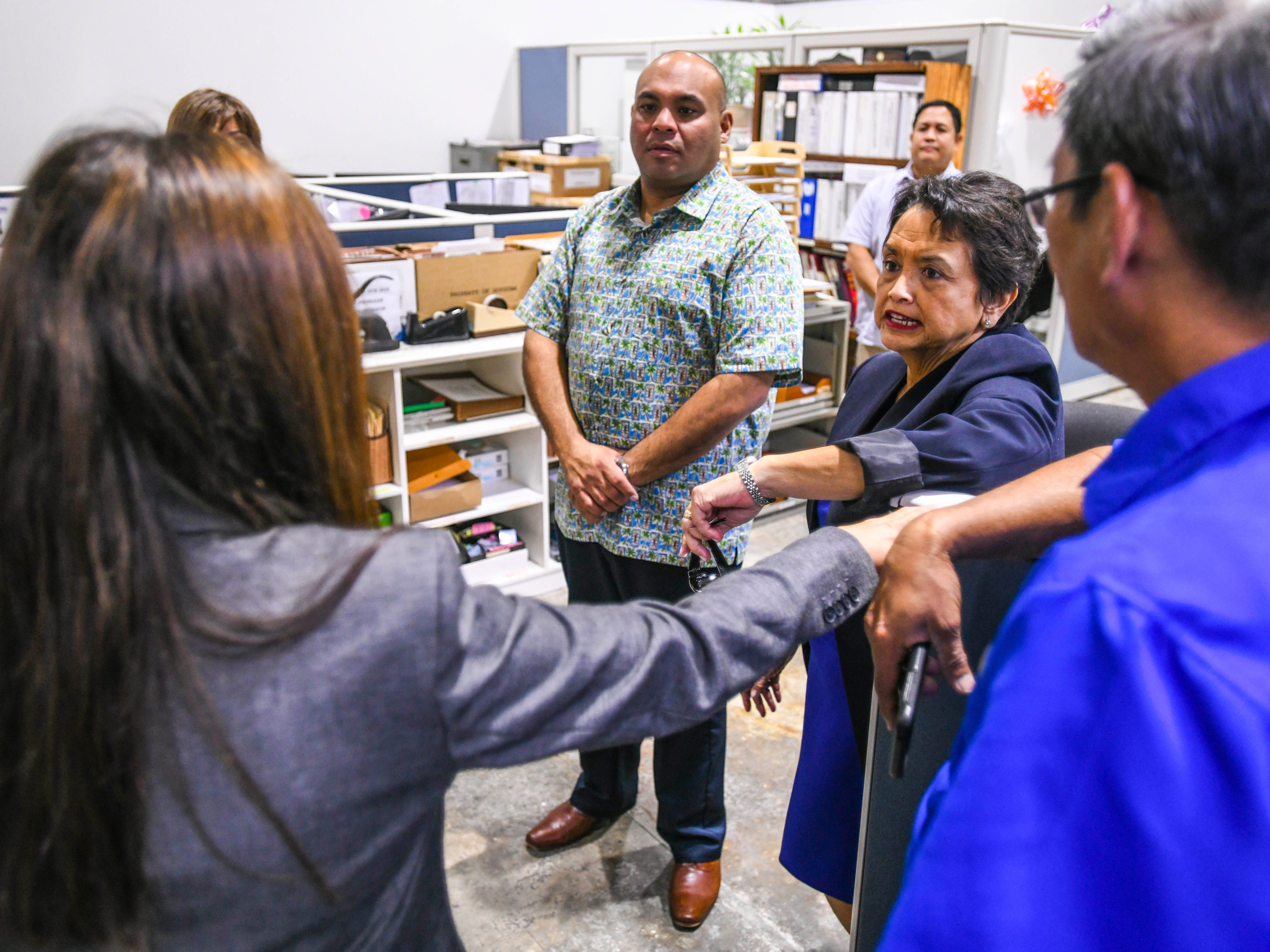 Gov. Lou Leon Guerrero, right, and Lt. Gov. Josh Tenorio, center, direct a question to Dafne Shimizu, Department of Revenue and Taxation acting director, as the new island administrators tour the agency in Barrigada Heights on Tuesday, Jan. 8, 2019.