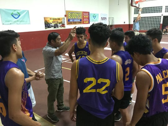 George Washington Geckos' head coach Lawrence Luces  on Monday talks to his team during their match against the Father Duenas Friars at the 2019 GSPN Boys' Preseason Basketball tournament at the FD Jungle gym. The Geckos (2-2) lost 74-51 to the Friars who move to 3-0 in the tournament.