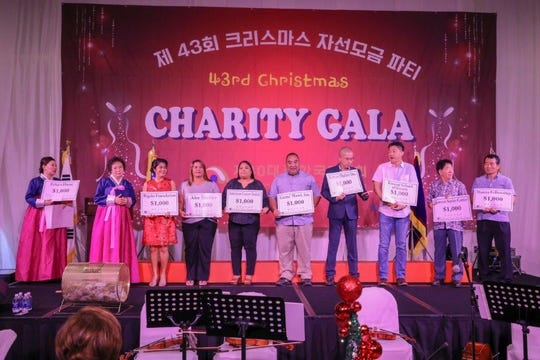 The Korean Women's Association of Guam distributed part of the funds raised to the beneficiaries of their 43rd Christmas Charity Gala, held on November 27, 2018 at the Hyatt Regency Hotel Guam. The gala event benefited 12 of Guam's nonprofit organizations selected.Pictured from left: KWAG Secretary, Nina Lee, President Sunok E. Chi, beneficiaries representatives, Rigalu Foundation (First Lady Christine Calvo), Alee Shelter, American Cancer Society, Guma' Mami Inc., Korean Shelter Inc, Korean School of Guam, Korean Senior Center, Manna Fellowship. (Not in photo/not present:  American Red Cross, Erica's House, Salvation Army Corps., Shriner's Hospital for Children).