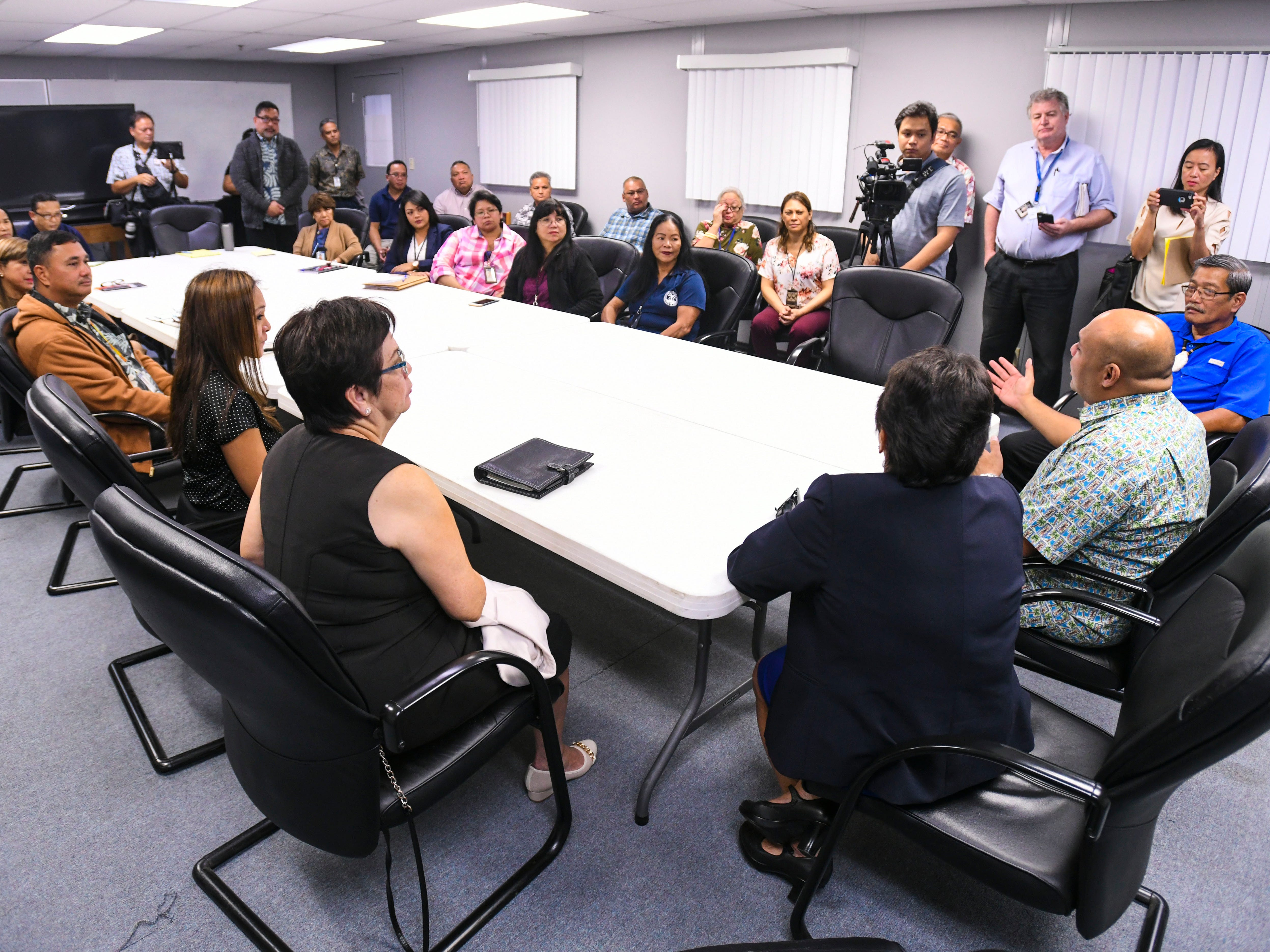 Lt. Gov. Josh Tenorio, right, expresses his appreciation for the work by the Department of Revenue and Taxation employees during a visit to the financial agency, with Gov. Lou Leon Guerrero, in Barrigada Heights on Tuesday, Jan. 8, 2019.