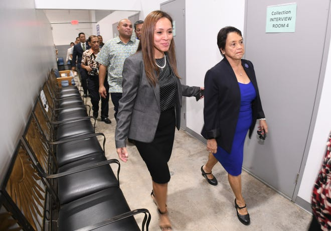 Dafne Shimizu, left, Department of Revenue and Taxation acting director, leads Gov. Lou Leon Guerrero and others on a tour of the agency in Barrigada Heights on Tuesday, Jan. 8, 2019.