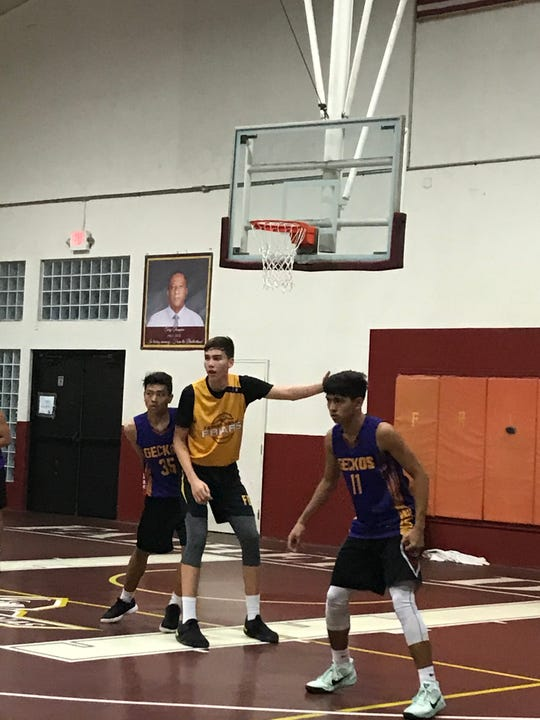 Father Duenas Friars' Matthew Fegurgur on Monday posts up against George Washington Geckos' John Mutuc during their game against the George Washington Geckos at the 2019 GSPN Boys' Preseason Basketball tournament at the FD Jungle gym. The Friars (3-0) beat the Geckos (2-2) 74-51.