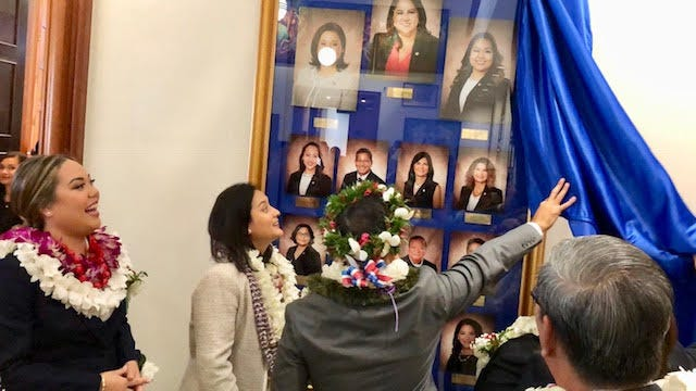 Newly sworn in senators unveil the wall photos of members of the 35th Legislature on Jan. 7, 2019.