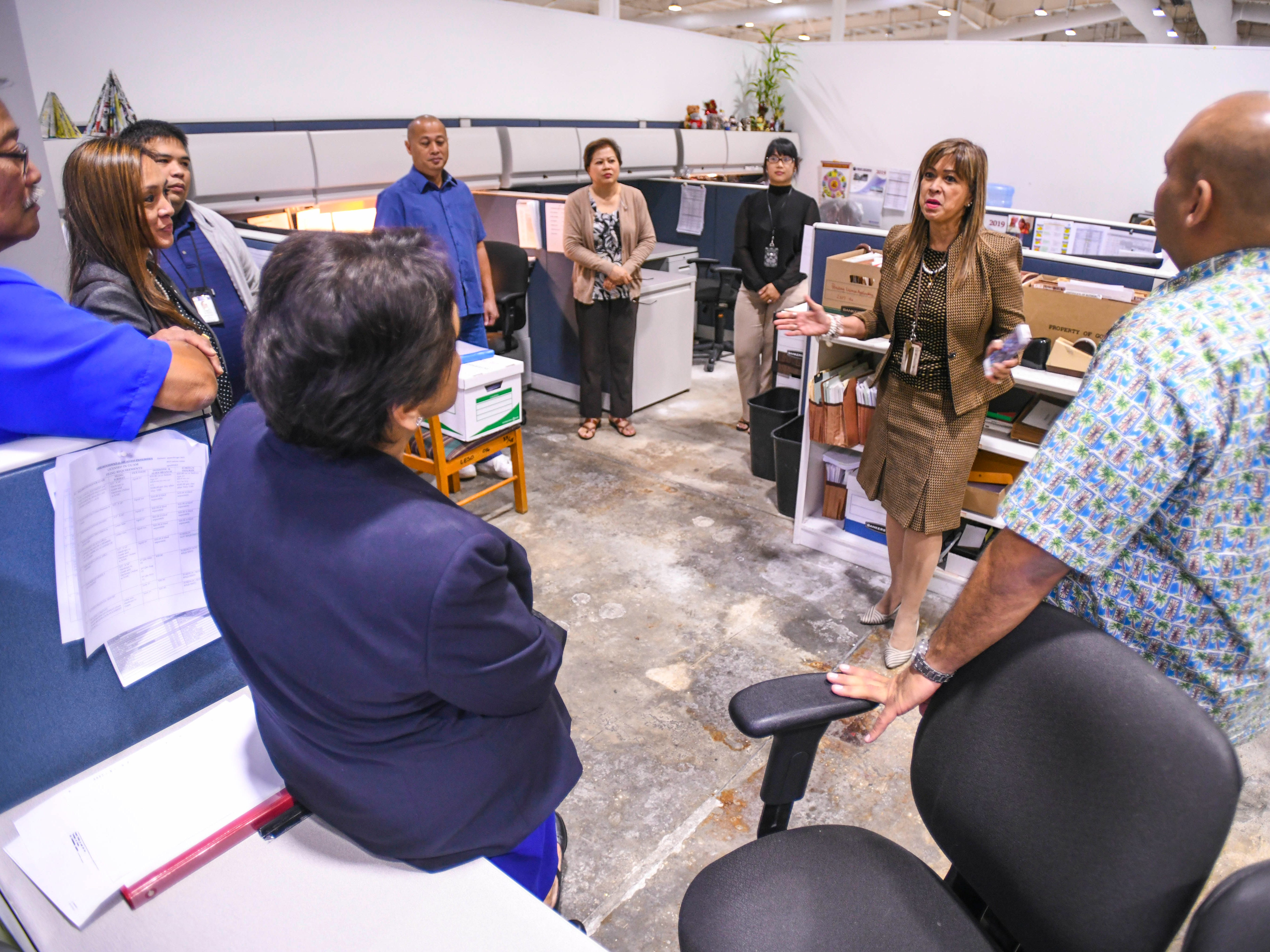 Regulatory Examiner Supervisor Alice Sabastian-Cruz, center, explains the function of the Insurance, Securities, Banking and Real Estate Division to Gov. Lou Leon Guerrero and Lt. Gov. Josh Tenorio, during their tour of the Department of Revenue and Taxation at Barrigada Heights on Tuesday, Jan. 8, 2019.