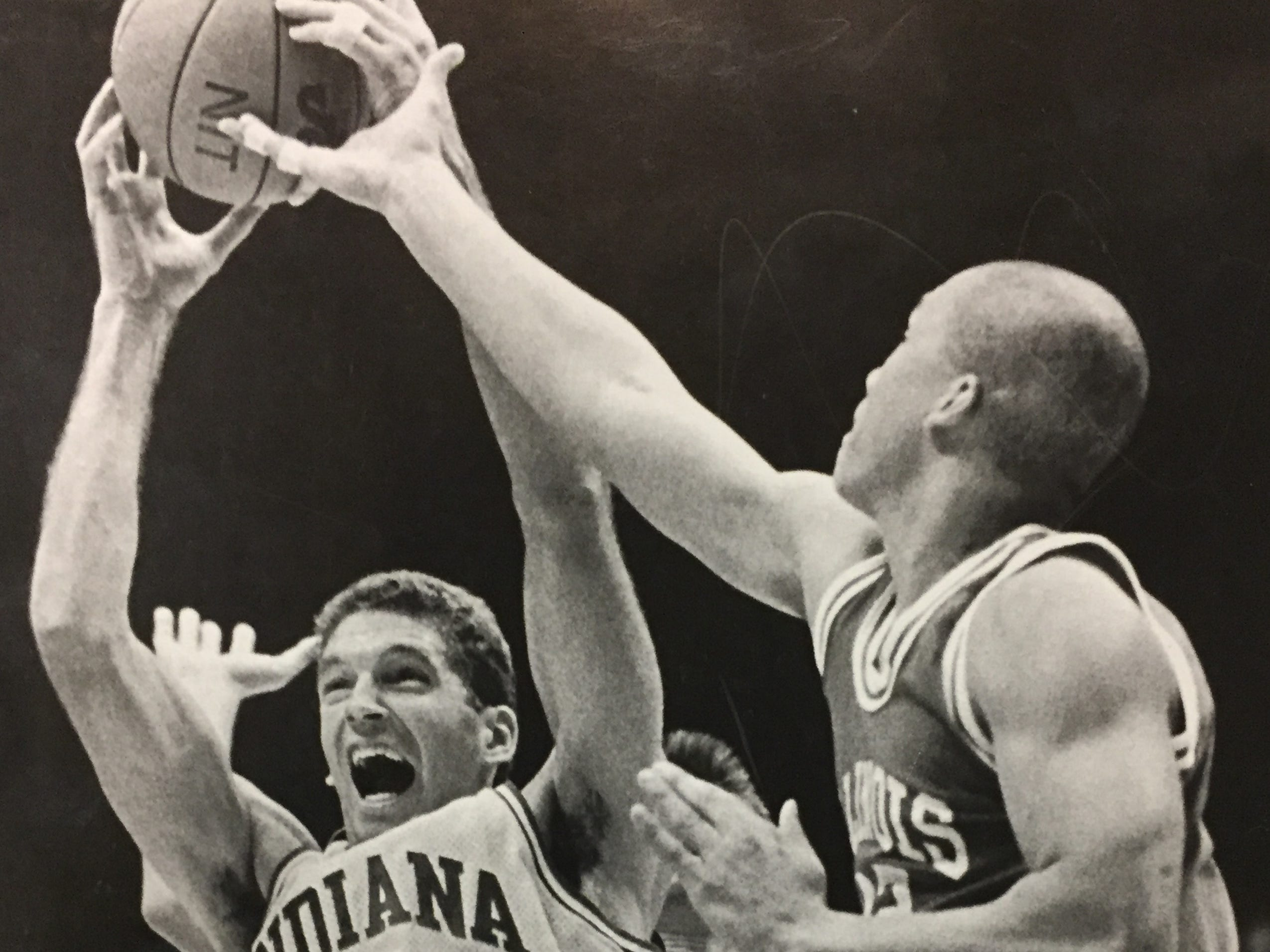 Indiana's Magnus Pelkowski (14) grimaces as he battles for a rebound with Illinois State's Scott Fowler and Sonny Roberts on Nov. 18, 1988.