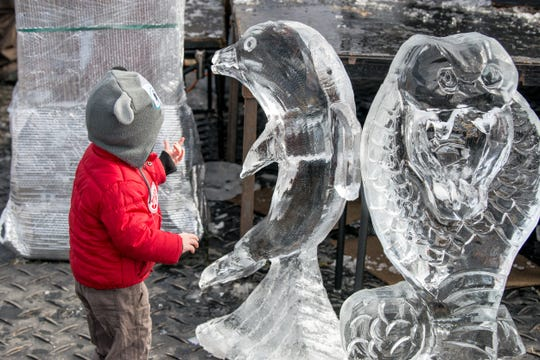 A child looks at ice sculptures during Carmel's 2018 Ice Festival