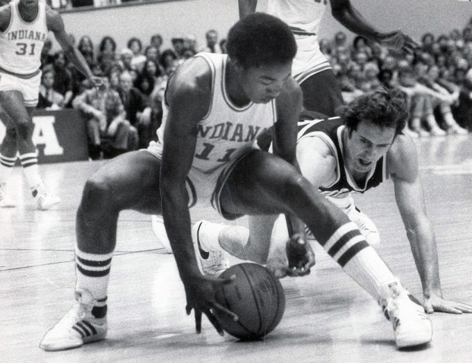 Indiana's Isiah Thomas and Purdue's Brian Walker battle for a loose ball.  Feb 1, 1981