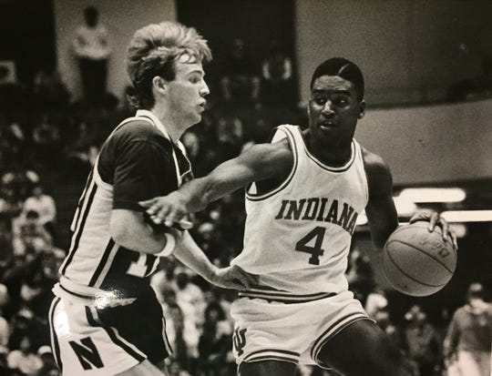 Indiana's Lyndon Jones uses his right arm to push away Northwestern defender Rob Ross on Jan. 15, 1989.