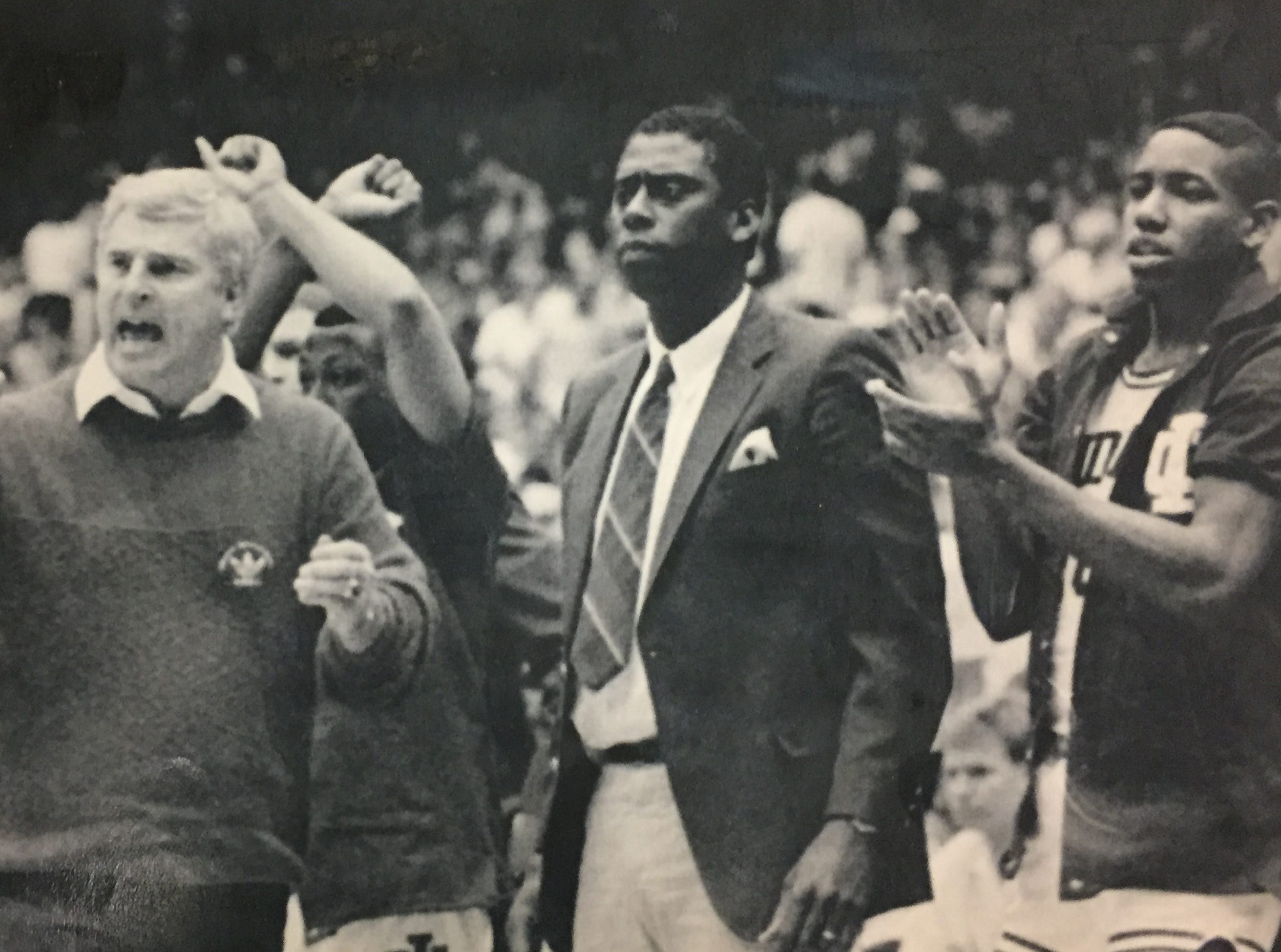 Bob Knight applauds the effort of his team late in the game against UTEP. Assistant coach Joby Wright and Mark Robinson concur on March 19, 1989.