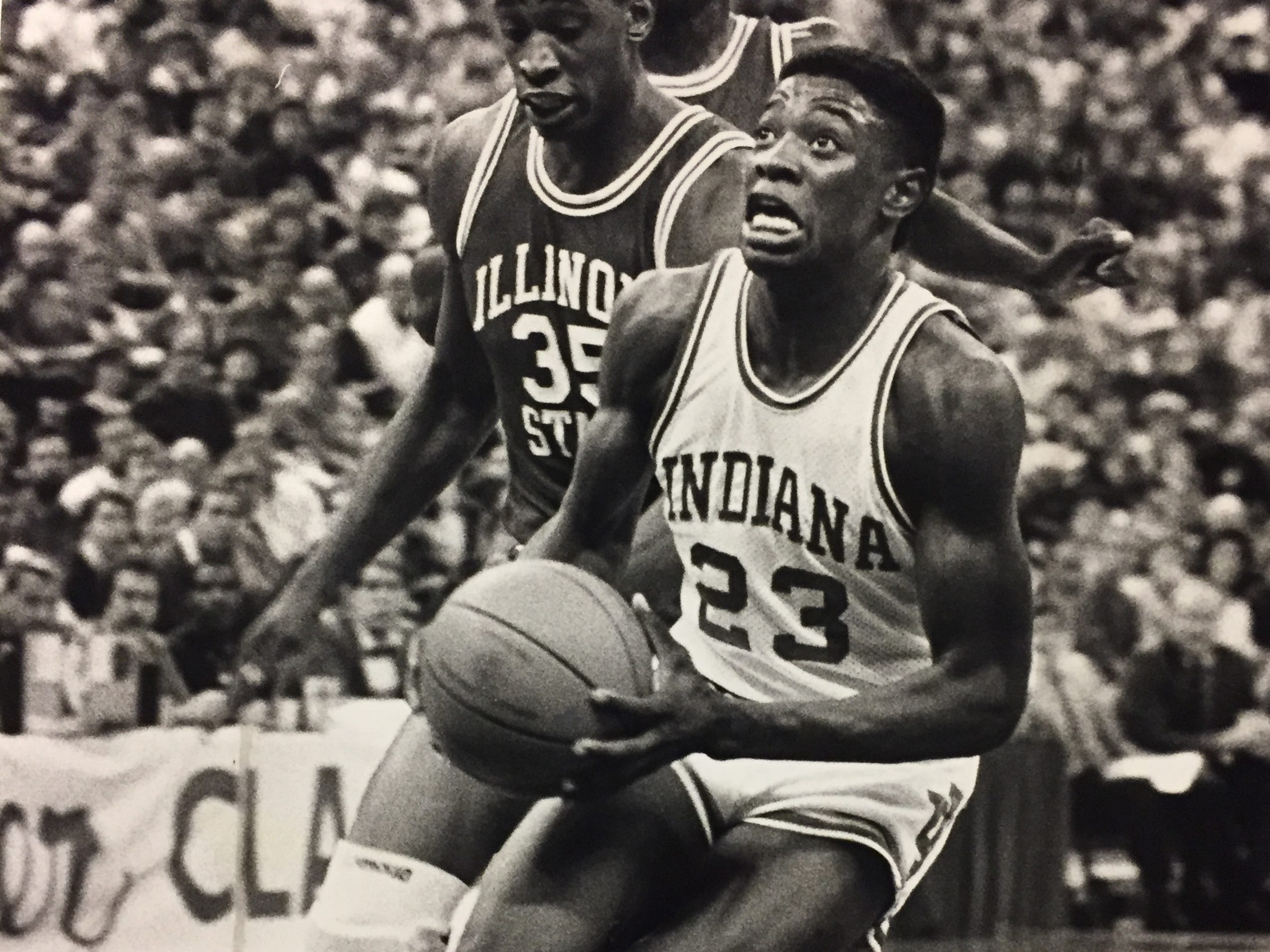 Keith Smart gets ready to score on the fast break as Illinois State's Derrick Sanders tried to catch the IU guard, Dec. 1986.