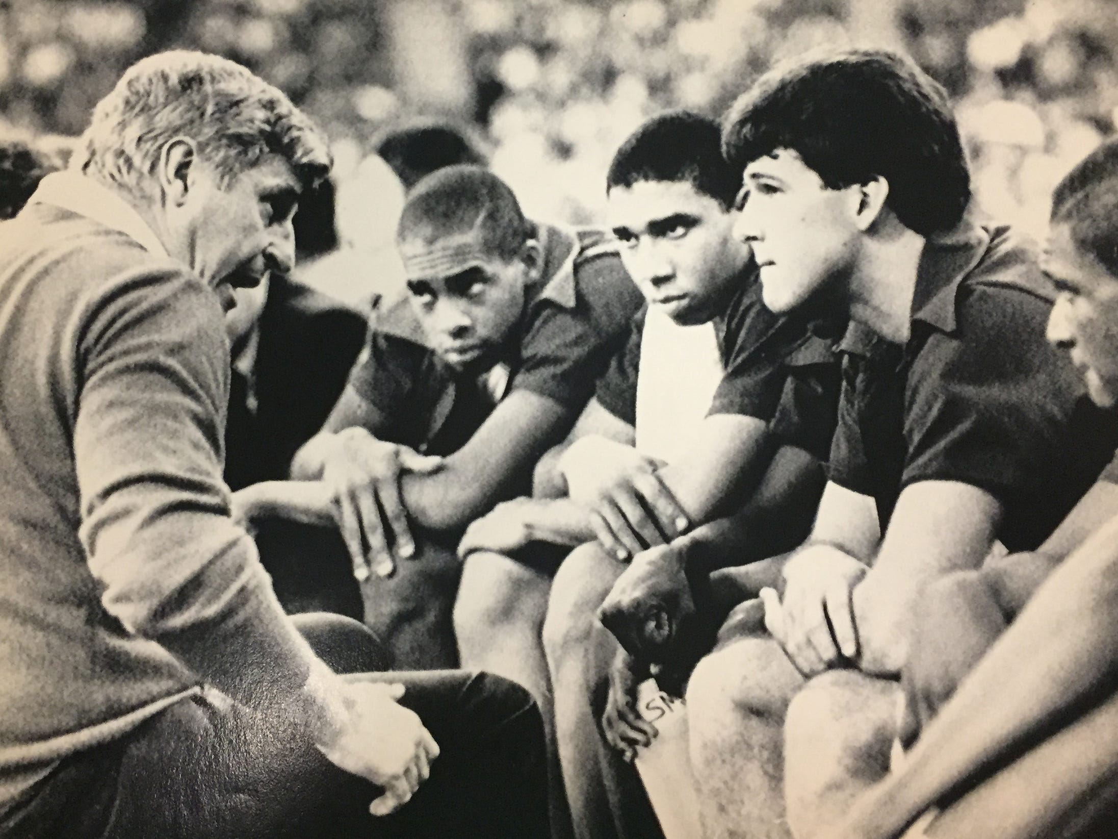 Bob Knight, left, talks with players during a timeout in the IU-Fairfield game in the first round of the 1987 NCAA tournament.