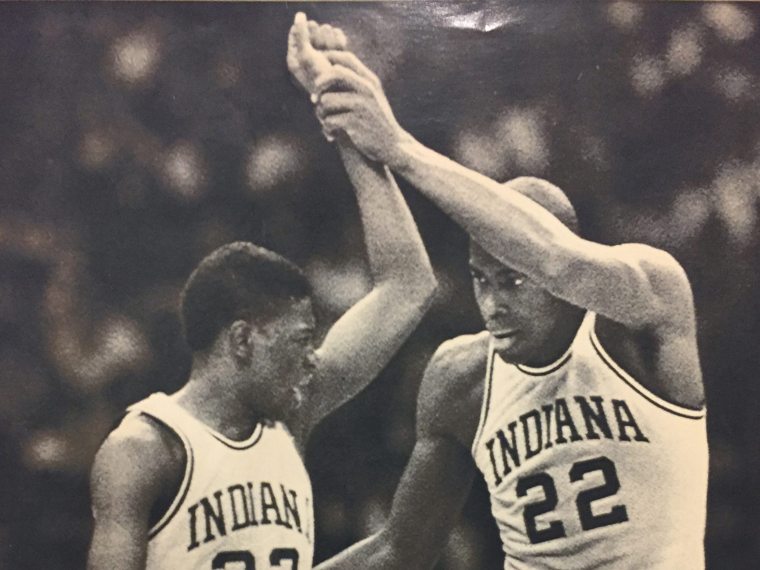 Indiana's Dean Garrett congratulates Keith Smart (23) after he scored against Syracuse during the NCAA championship game in New Orleans.