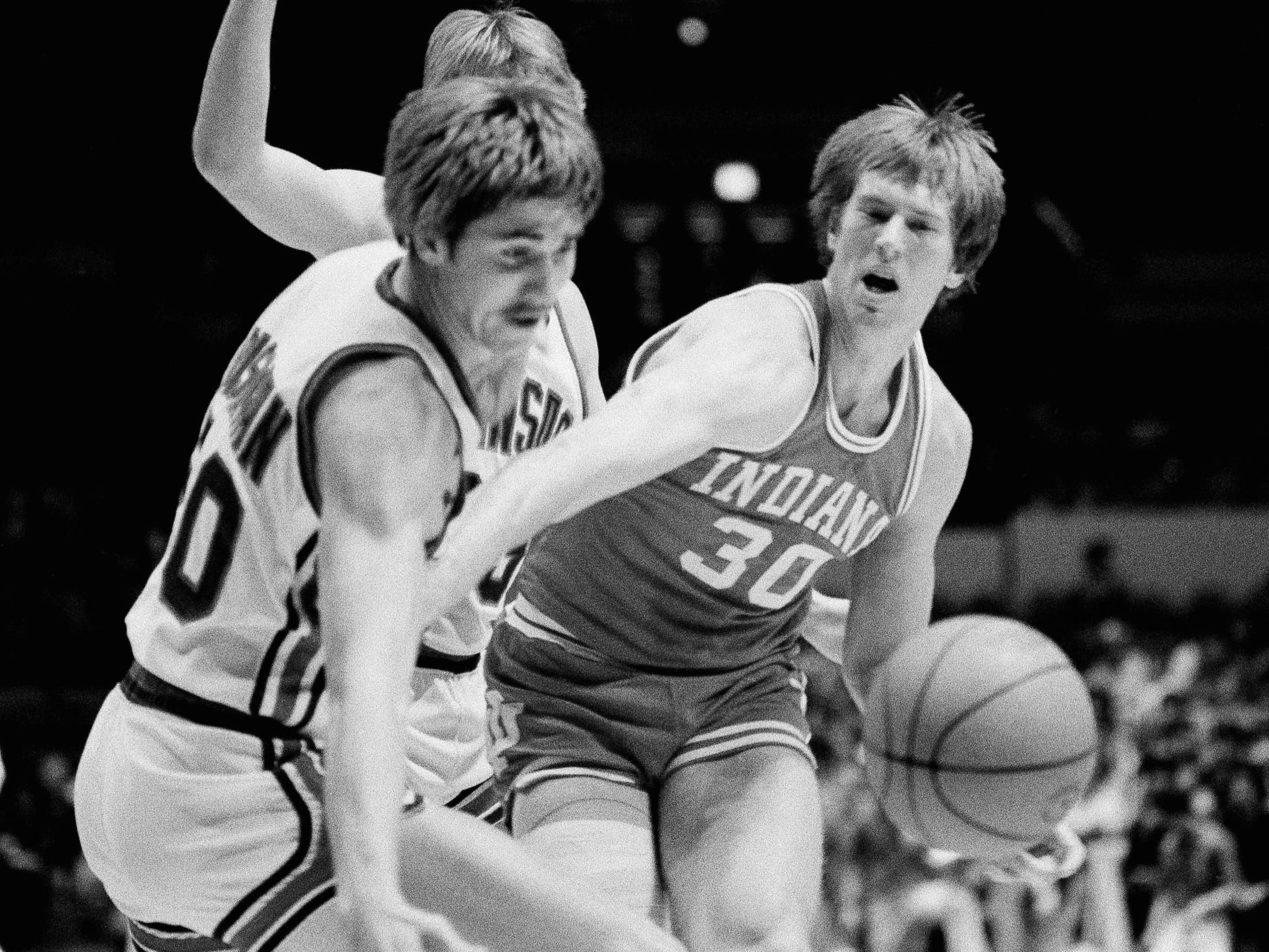 Indiana forward Ted Kitchel finds that he has little room to maneuver thanks to the tight defense of Kansas, center, Jeff Dishman, in the first half of the consolation game of the ECAC Holiday Festival at New York's Madison Square Garden December 29, 1981.