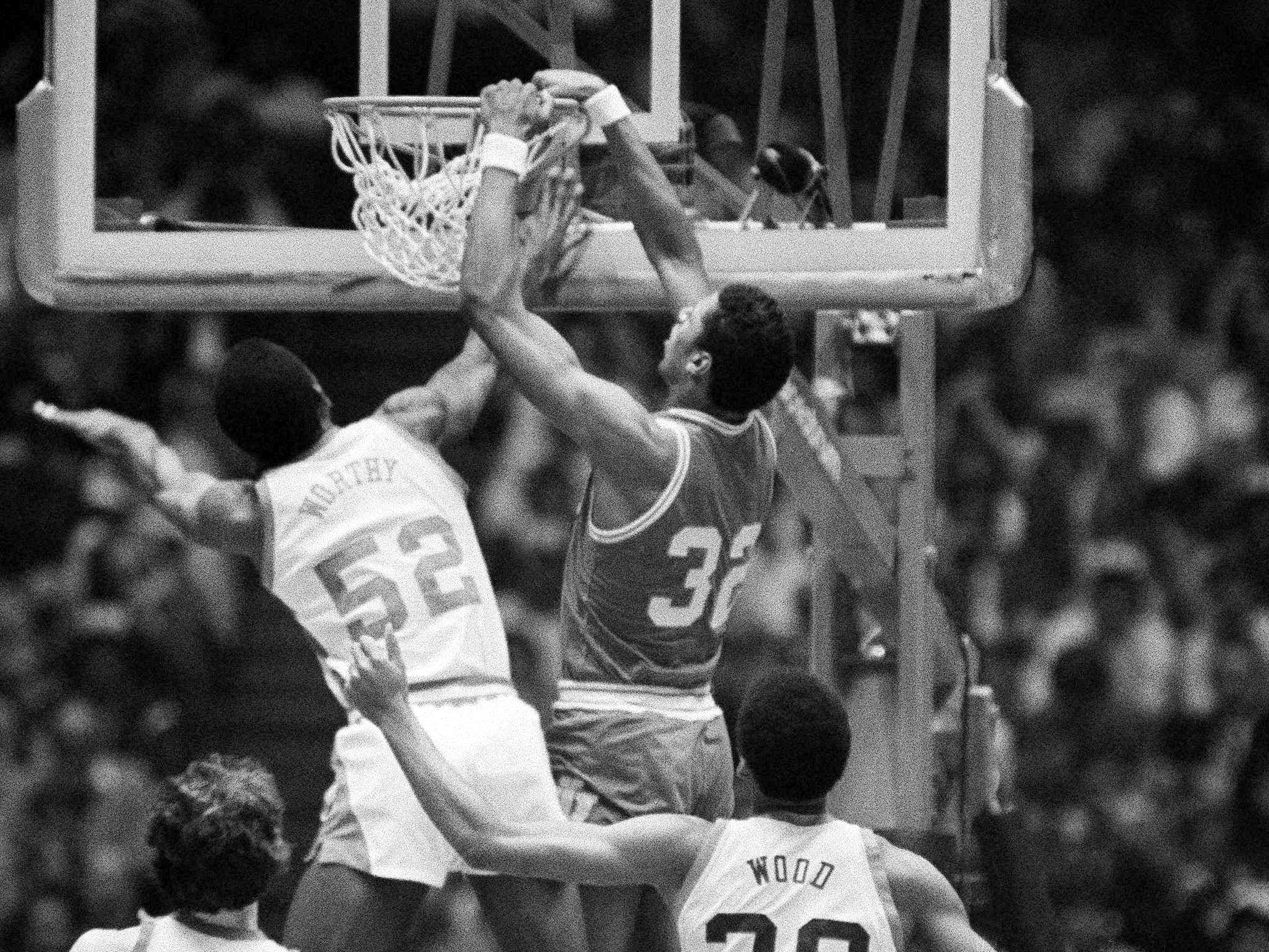 Indiana's Landon Turner (32), hangs onto rim while dunking ball at the NCAA playoff in Philadelphia on Monday, March 30, 1981. In on the play are James Worthy, left and Al Wood. A technical foul was called on the play.