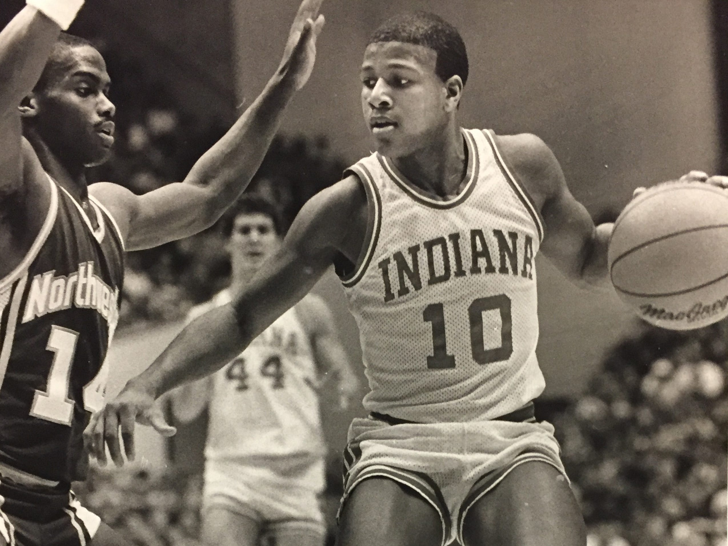 Hoosiers' Tony Freeman drives on Elliott Fuller of Northwestern in 1987.