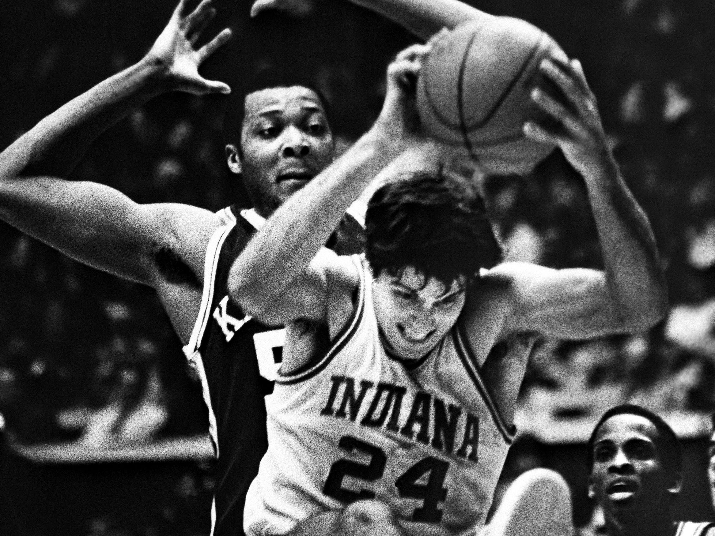 Indiana's Randy Wittman grabs a rebound in front of Melvin Turpin of Kentucky in Bloomington, December 22, 1982.
