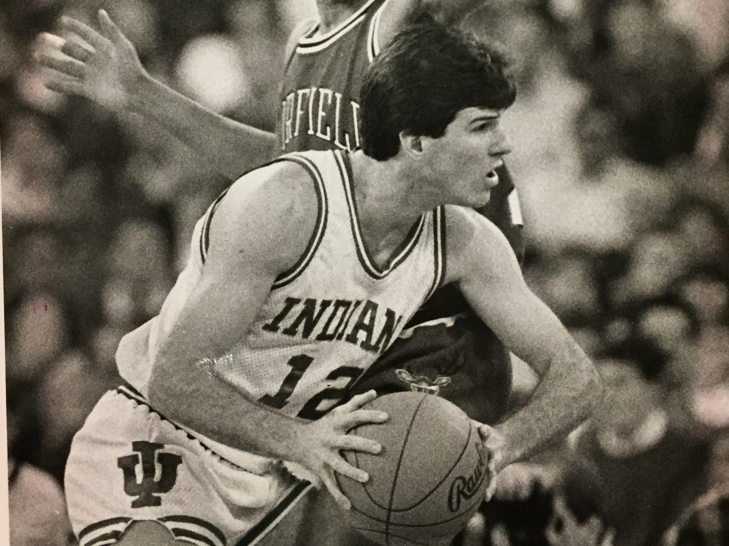 Steve Alford tries to push his way past Fairfield's A.J. Wynder during NCAA tournament first round game, March 12, 1987.