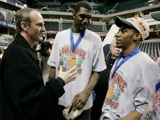 Ohio State coach Thad Matta, left, talks with Lawrence North's Greg Oden, middle and Mike Conley following Lawrence North 80-56 win over Muncie Central in the Class 4A championship game at the IHSAA basketball state finals March 25, 2006.