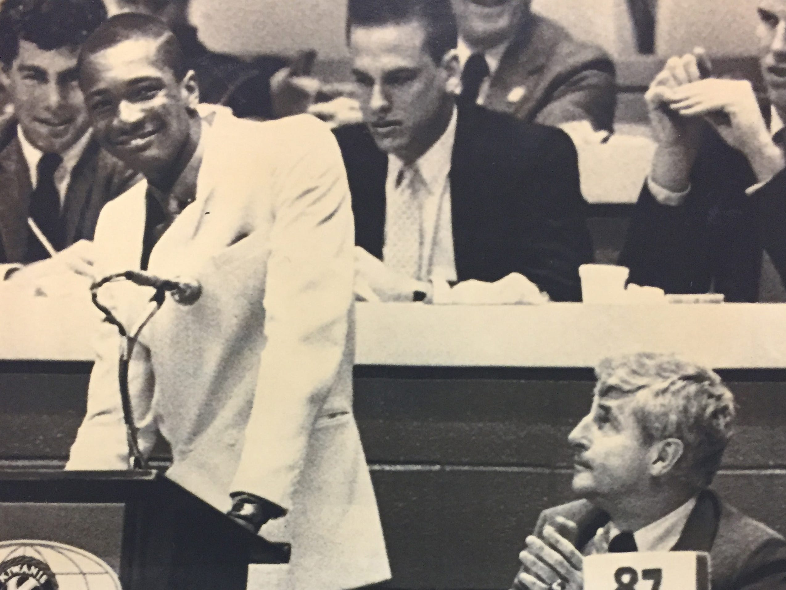 Rick Calloway is all smiles at the podium of the Kiwanis Club as Bob Knight looks on in April 1987.
