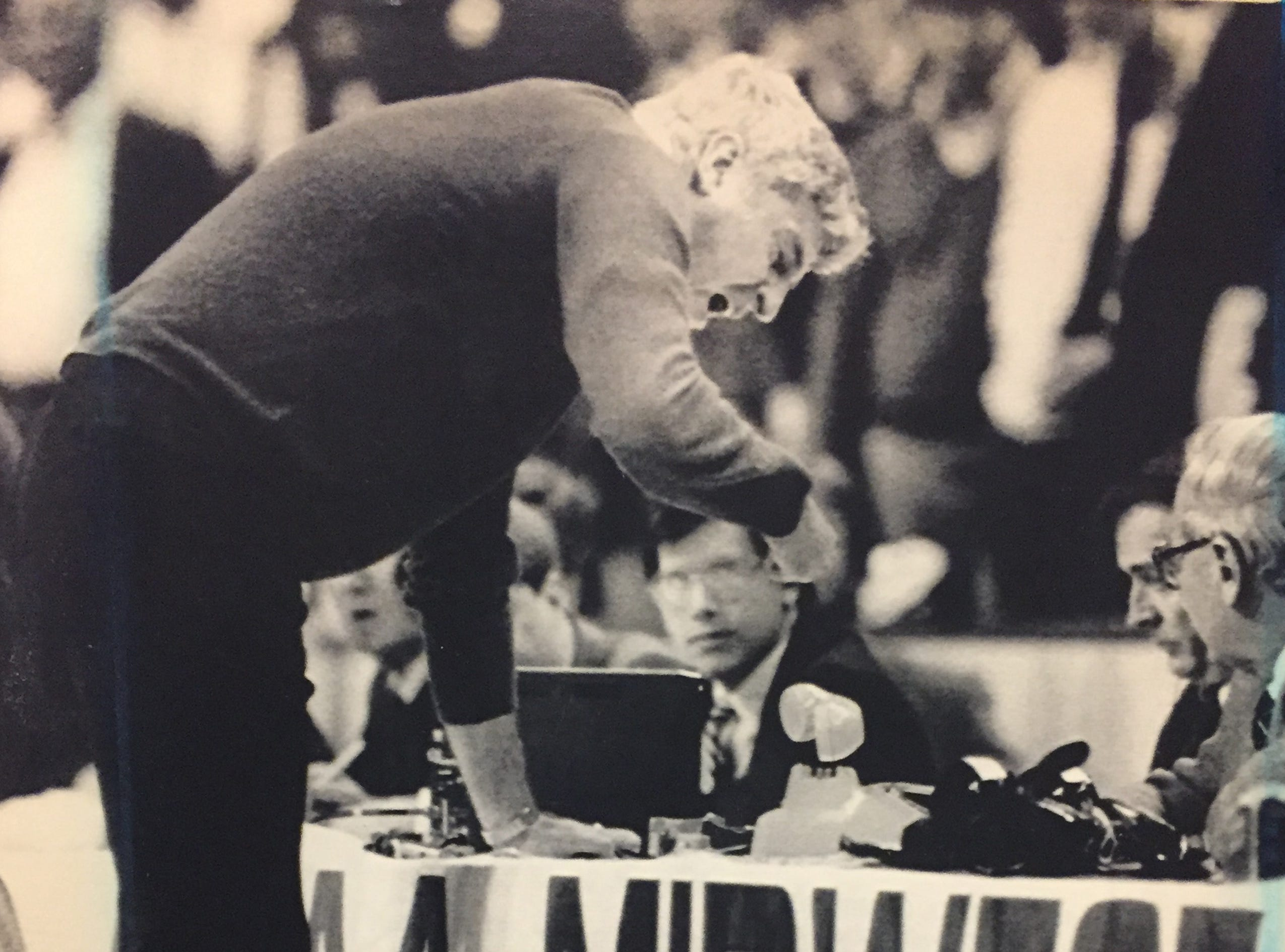 Bob Knight strikes his fist on the scorer's table, sending a telephone handset flying after he was called for a technical foul against LSU on March 22, 1987.
