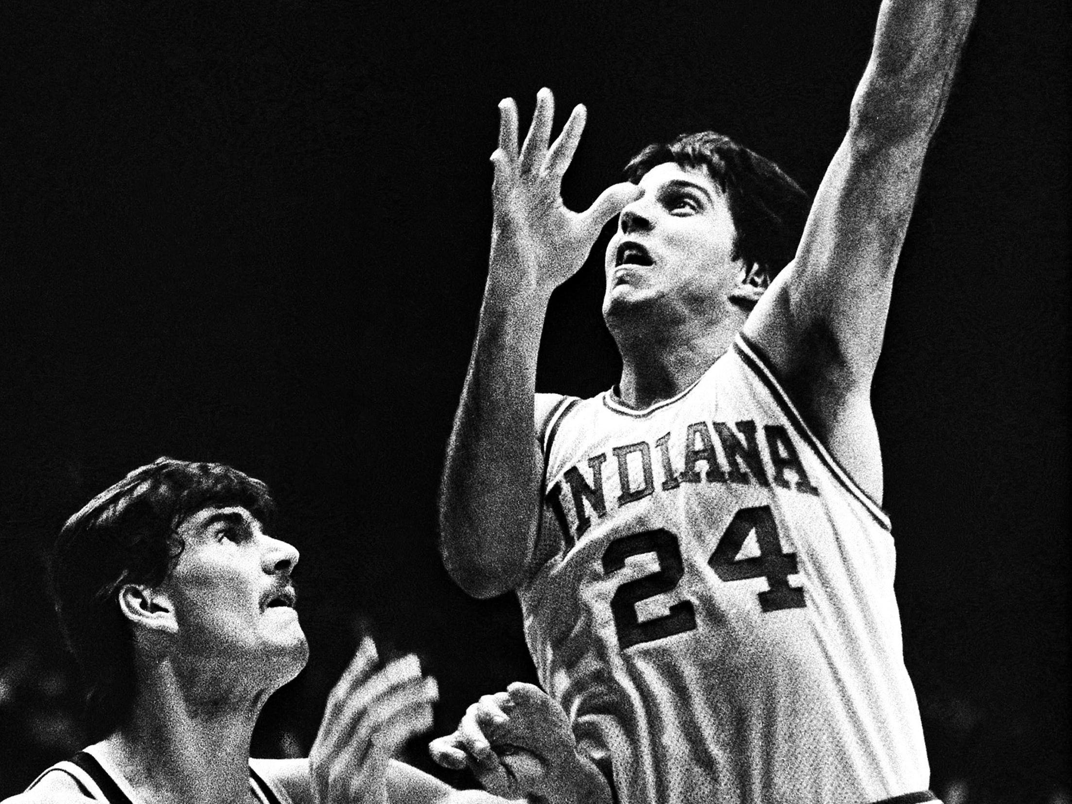 Indiana University's Randy Wittman (24) sends an alley-oop shot over Wyoming's Mark Wrapp (50) during first half action in the championship match of the Indiana Classic basketball tournament at Assembly Hall December 11, 1982.