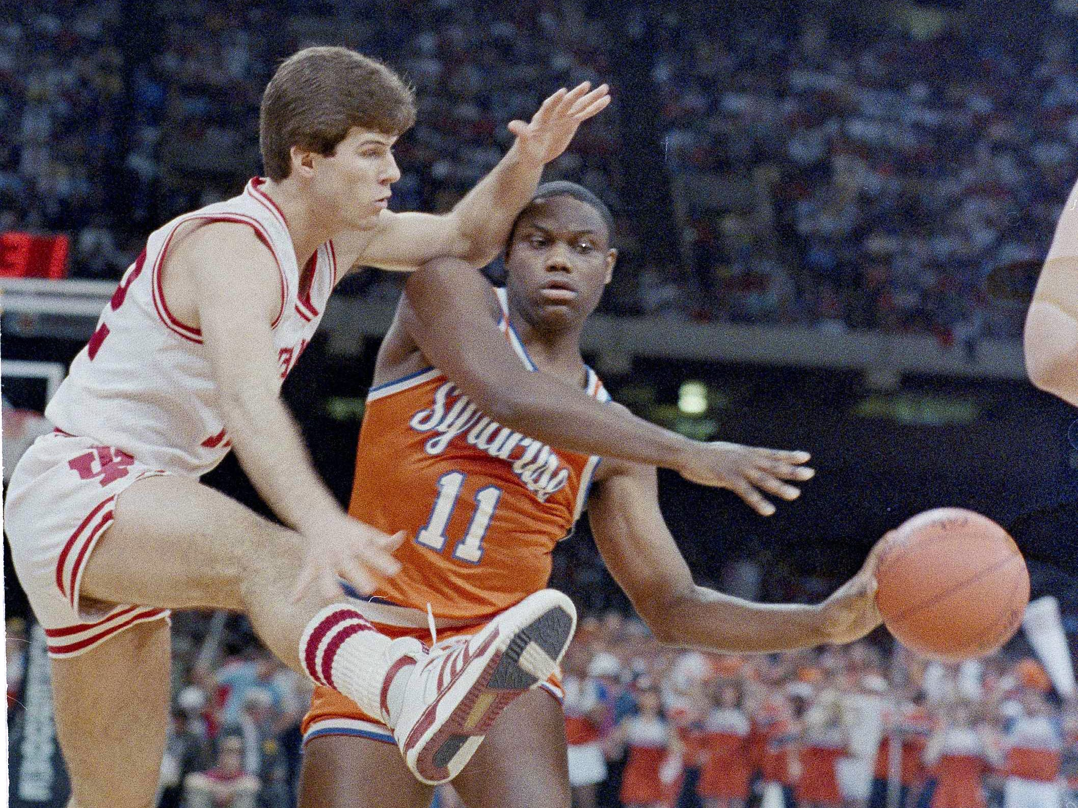 Indiana's Steve Alford tries to block a pass by Syracuse's Greg Monroe, 11, during action in the NCAA Championship game in New Orleans Monday, March 30, 1987.