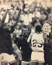 Coach Bob Knight hugs Keith Smart (23) as he leaves the floor to the cheers of Dean Garrett (left) and Rick Calloway in the waning seconds of their second round win over Auburn in the 1987 NCAA tournament.