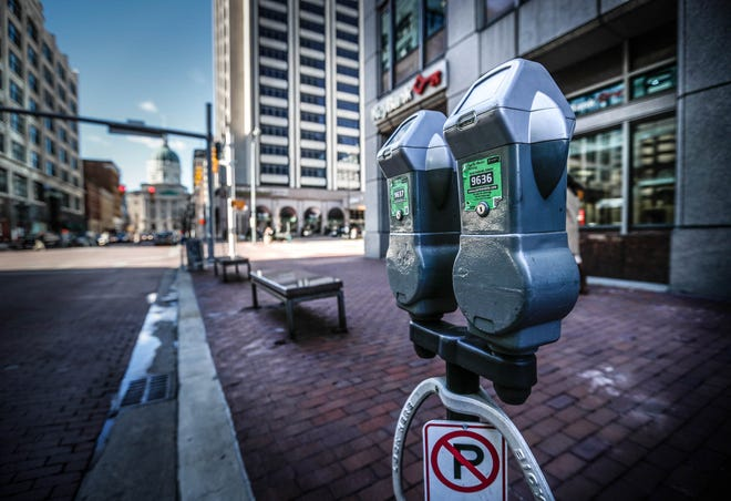 Parking meters line the street in downtown Indianapolis on Tuesday, Jan. 8, 2019. The Department of Public Works projects the new extended parking meter hours, to 11pm, will generate an additional $800,000 a year which the city can put toward Street sweeping, panhandling and homelessness.