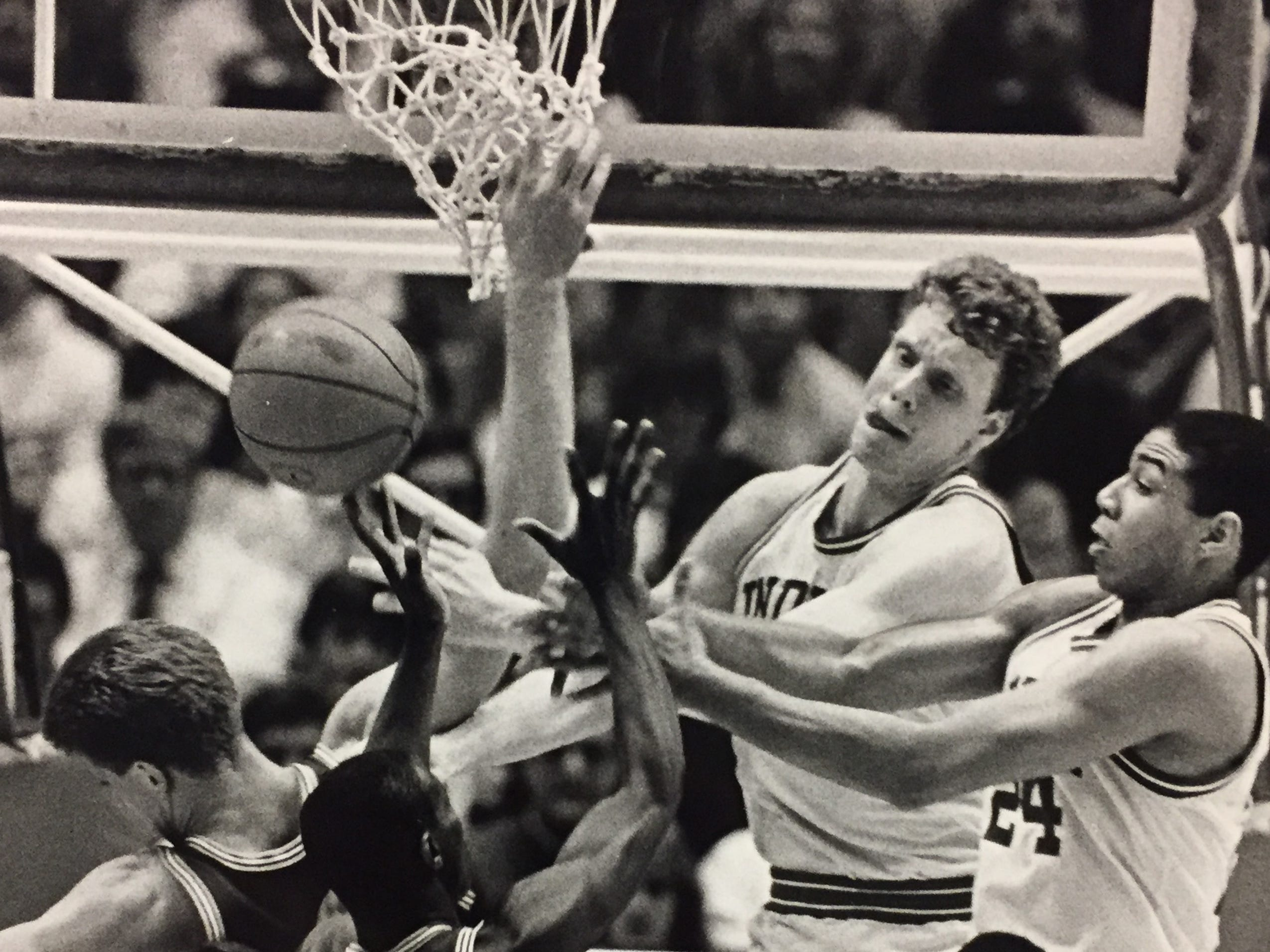 A Marquette miss ignited a wild scramble for the rebound as Indiana's Kreigh Smith, Uwe Blab, Daryl Thomas and Stew Robinson all go for the ball on March 24, 1985 in the NIT.