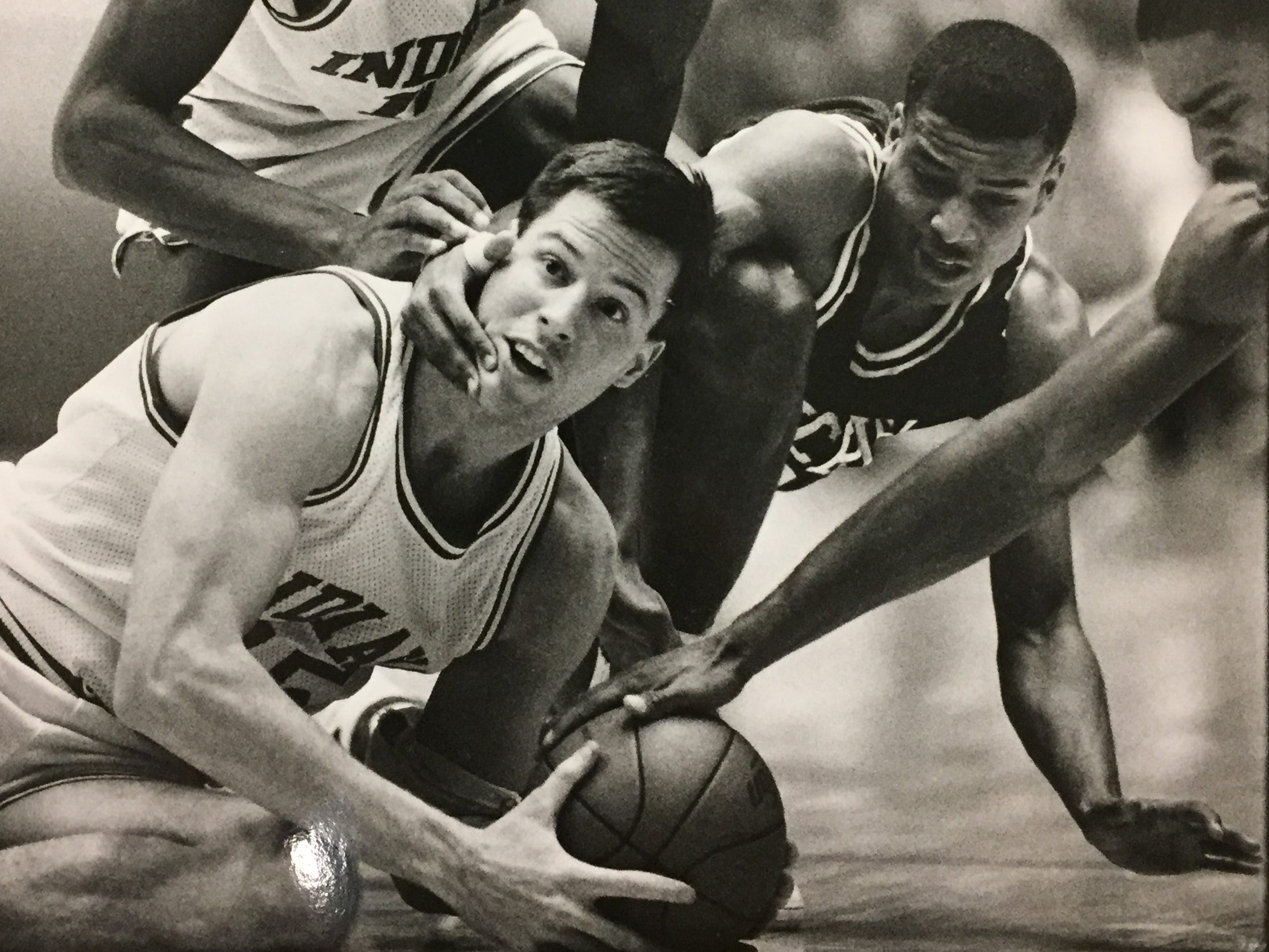 IU's Brian Sloan (center) fights for a loose ball against Michigan State, Jan. 21, 1989.