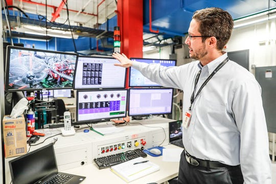Rick Davis, director of Columbus test operations, explains how Cummins engines are rigorously tested in test cells like the one shown here at the Cummins Technical Center.