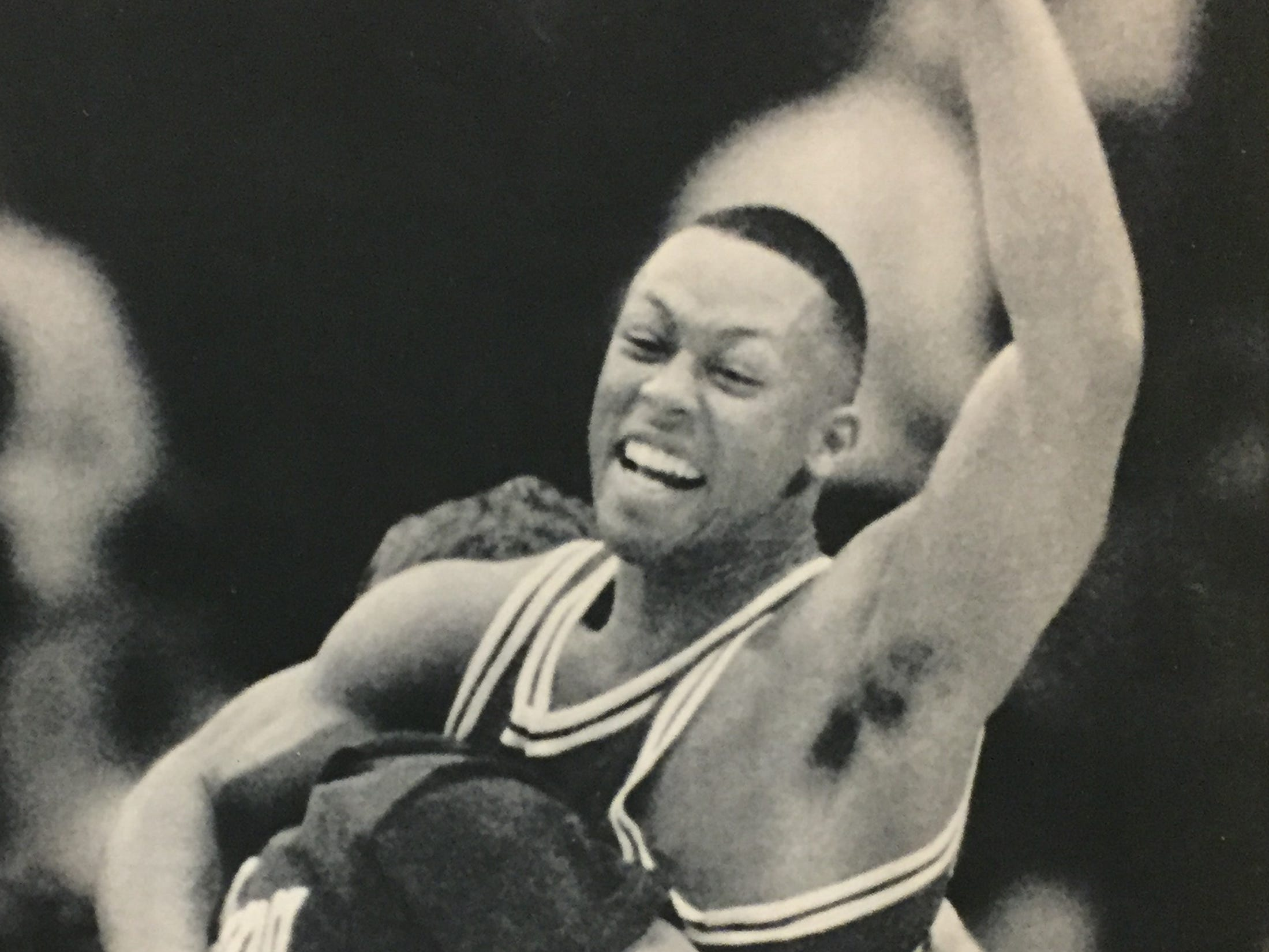 Jamaal Meeks gets a victory hug while celebrating IU's 71-70 win over Michigan at Crisler Arena, Jan. 23, 1989.