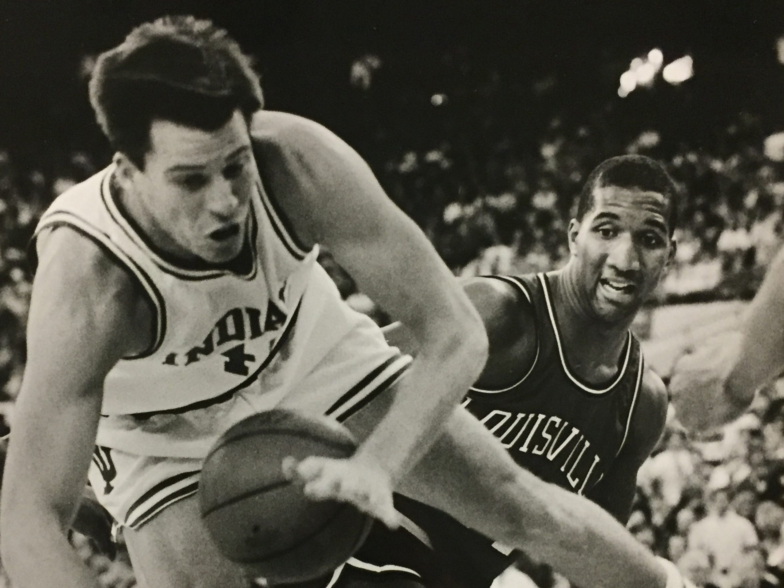 Indiana's Brian Sloan is fouled as he shoots by Louisville's James Brewer during the first half of the Big Four Classic in the Hoosier Dome, Dec. 3, 1988.