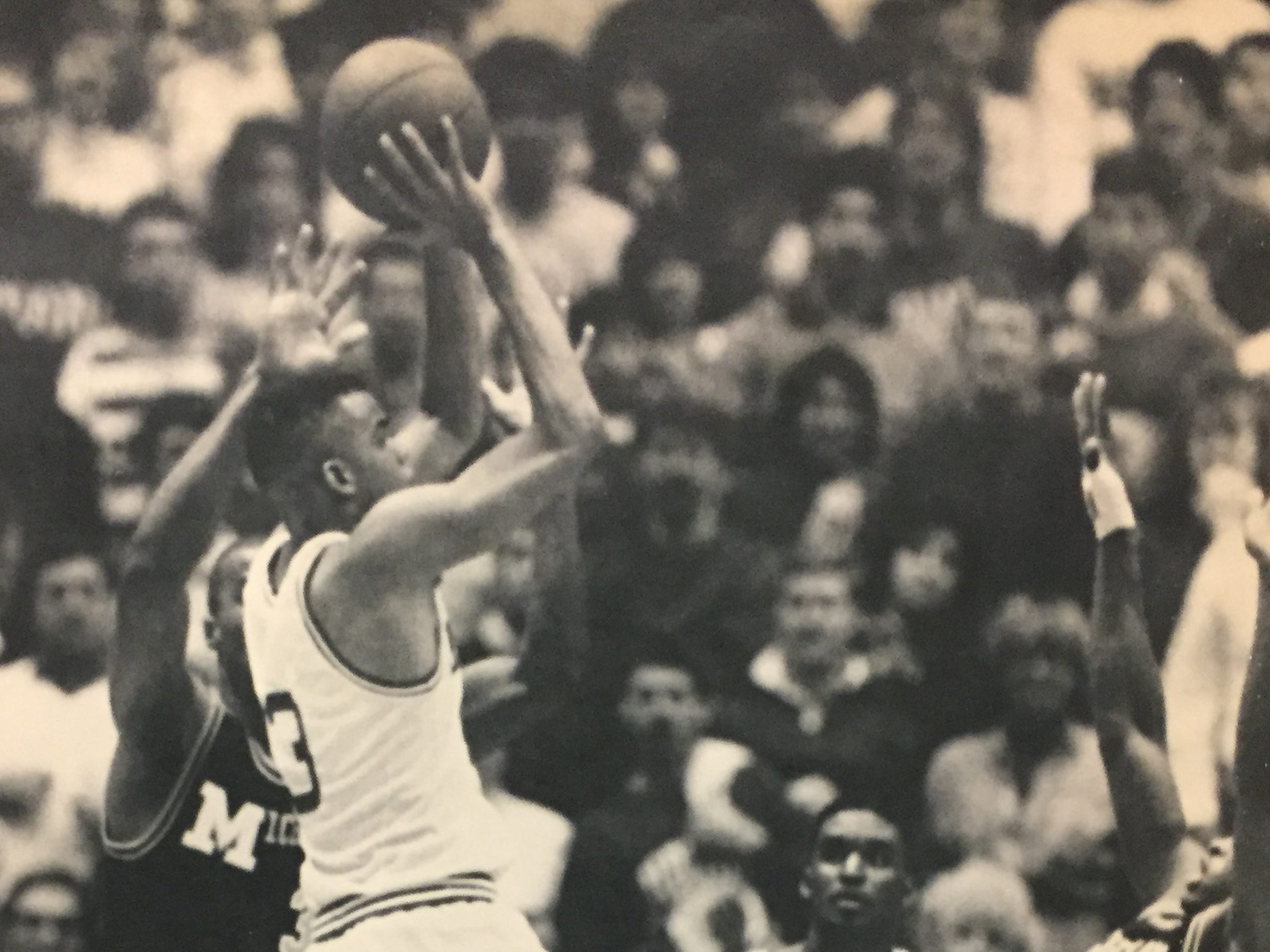 Jay Edwards shoots a 3-pointer over Michigan's Loy Vaught, left, and Rumeal Robinson to help IU defeat the Wolverines 76-75, Feb. 19, 1989.