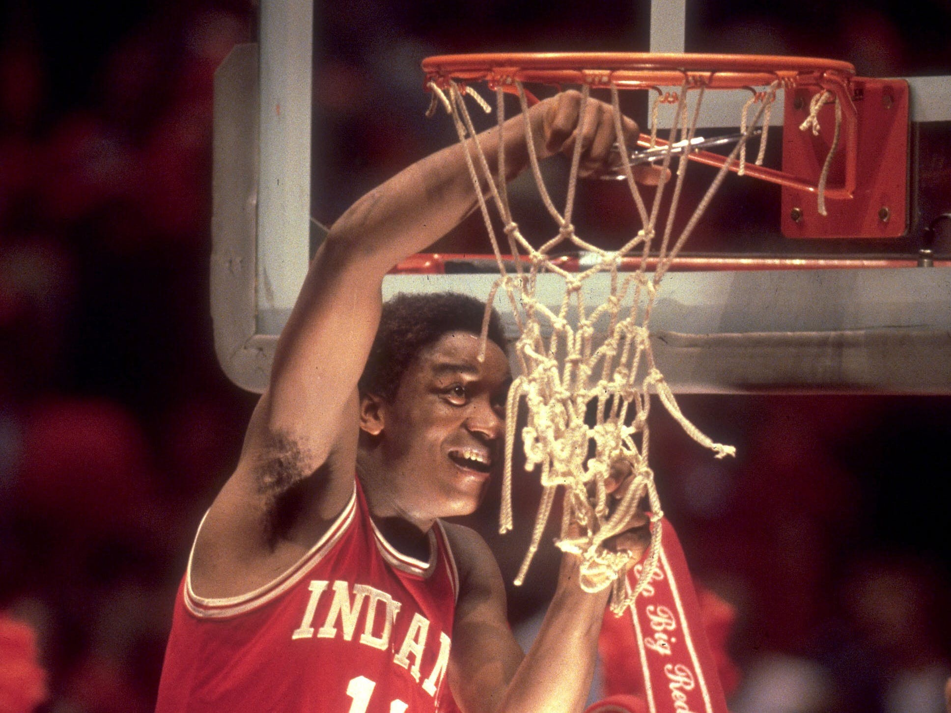 Indiana guard Isiah Thomas (11) cuts the net after winning the NCAA Men's National Basketball semifinal game held in Philadelphia PA at The Spectrum. Indiana defeated LSU 67-49 in March 1981.