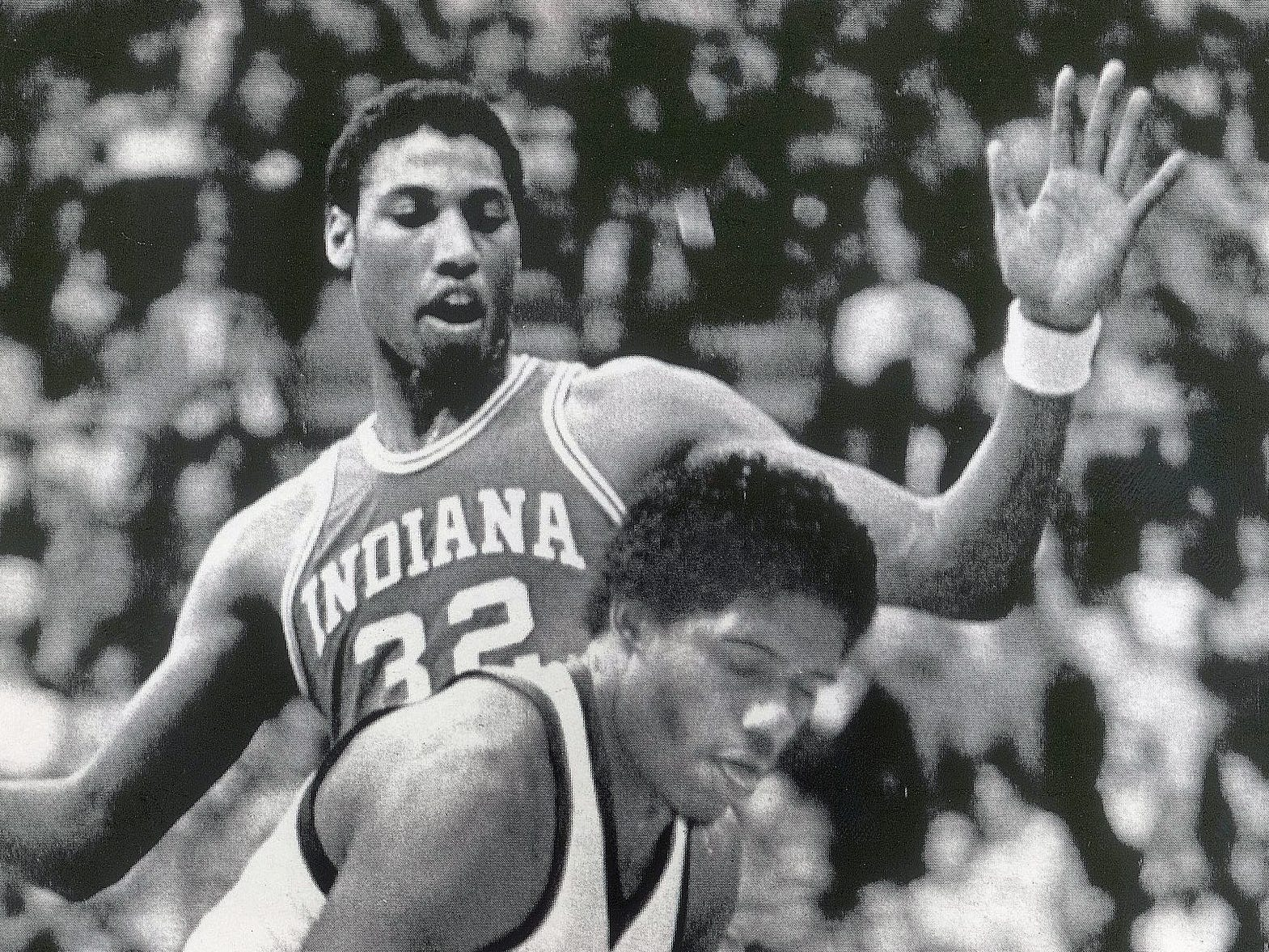 Michigan Sate's Jay Vincent tries to control the basketball under his basket while Indiana's Landon Turner defends him during the Big Ten game played March 7, 1981.
