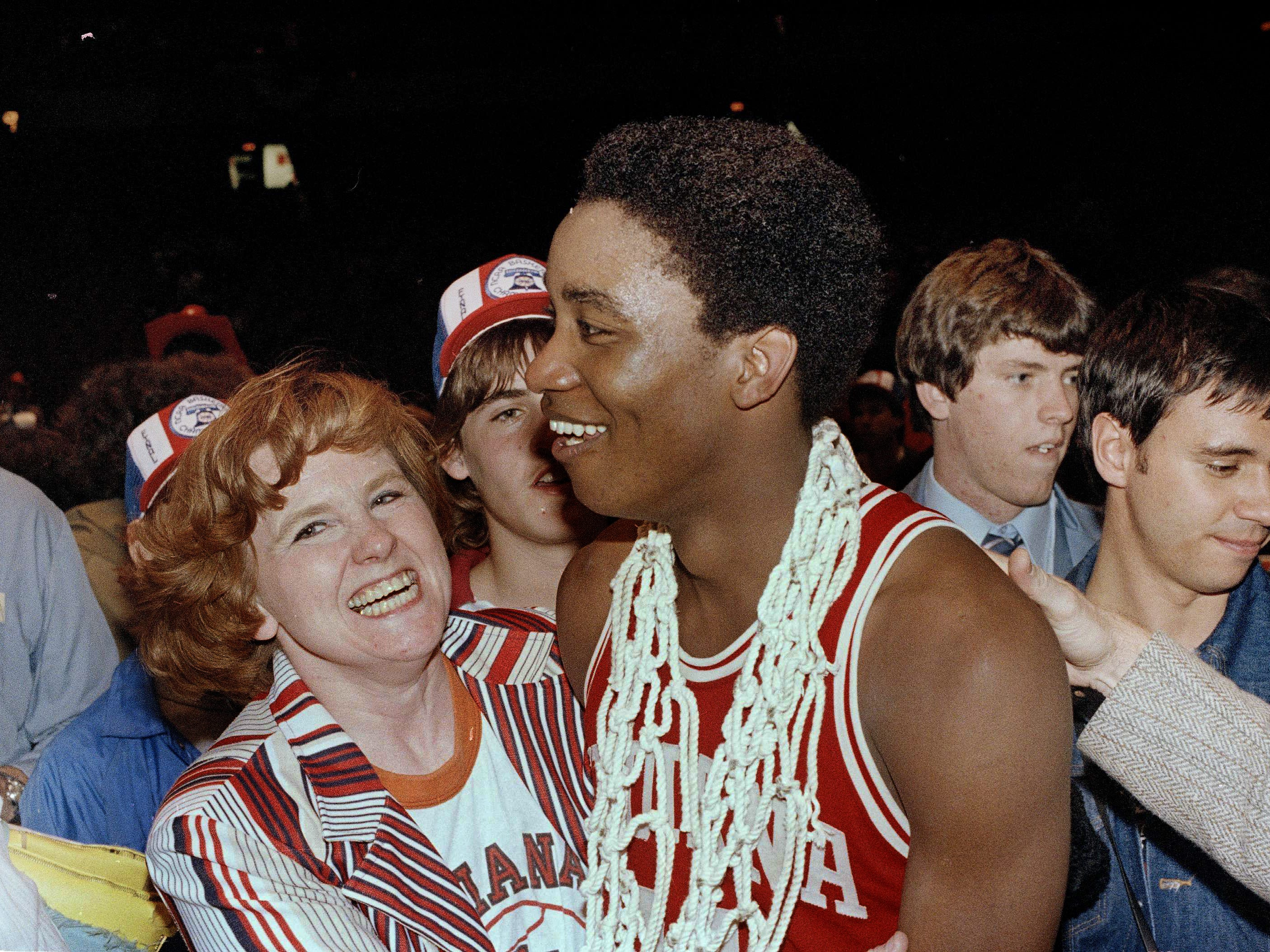 Isiah Thomas of Indiana University wears the net from the basket around his neck and is surrounded by fans after his team won over North Carolina, 63-50, in the final NCAA championship game, March 31, 1981. Thomas was declared MVP of the game in Philadelphia.
