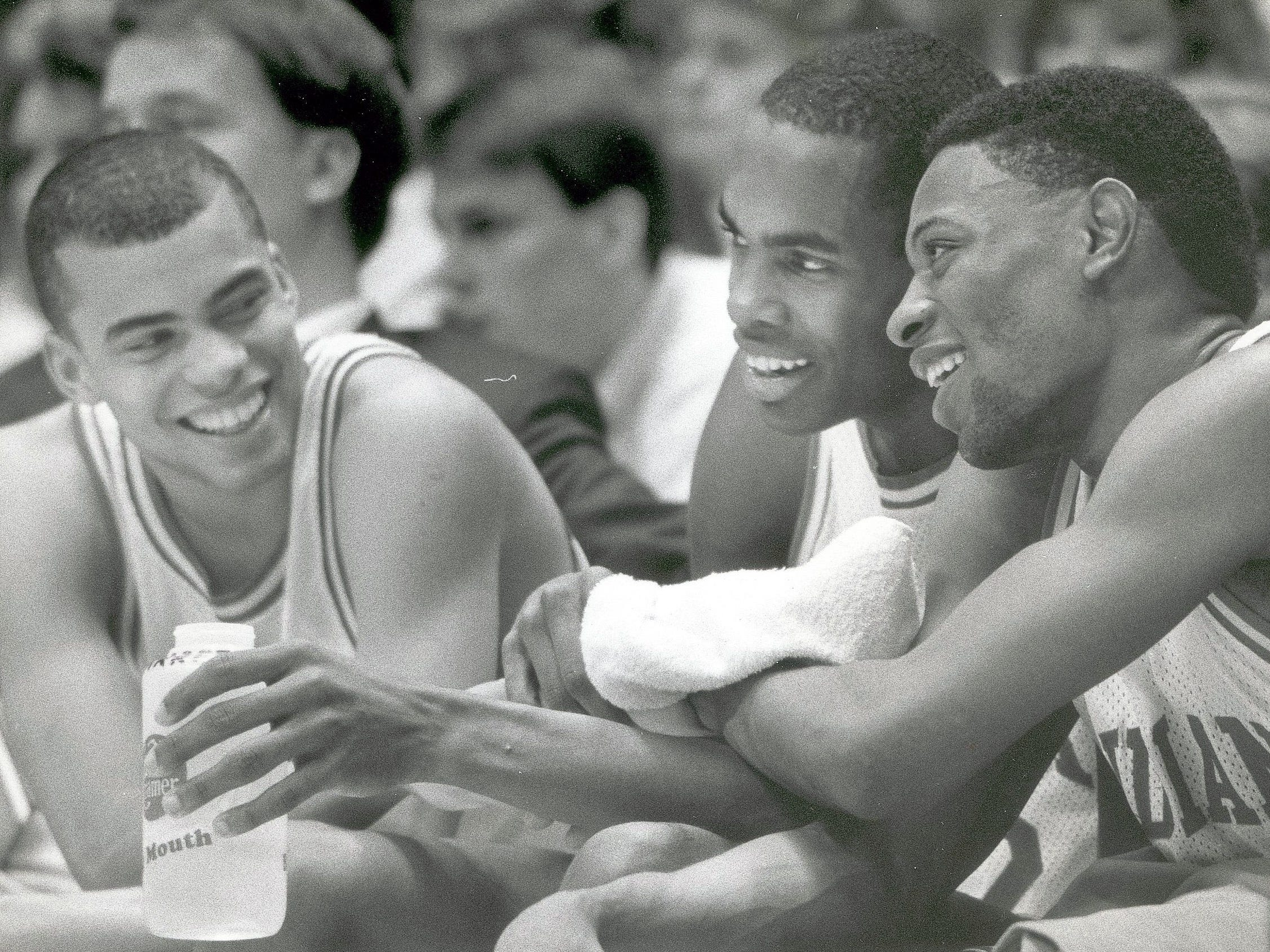 Indiana players from left, Jay Edwards, Dean Garrett and Keith Smart celebrate a Hoosiier victory from the bench. March 13, 1988.