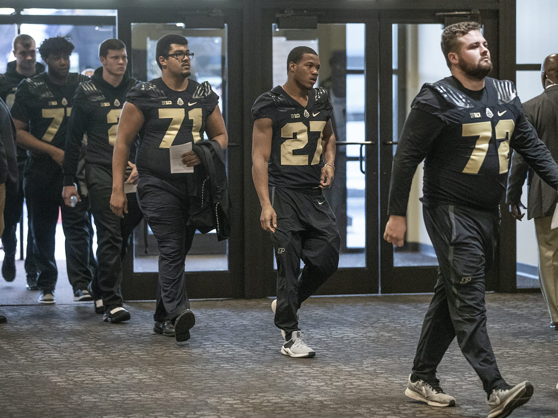 Members of the Purdue football team enter the funeral for former Purdue student and superfan Tyler Trent at College Park Church in Indianapolis, Tuesday, Jan. 8, 2019. The 20-year-old died of a rare form of bone cancer on Jan. 1, 2019.