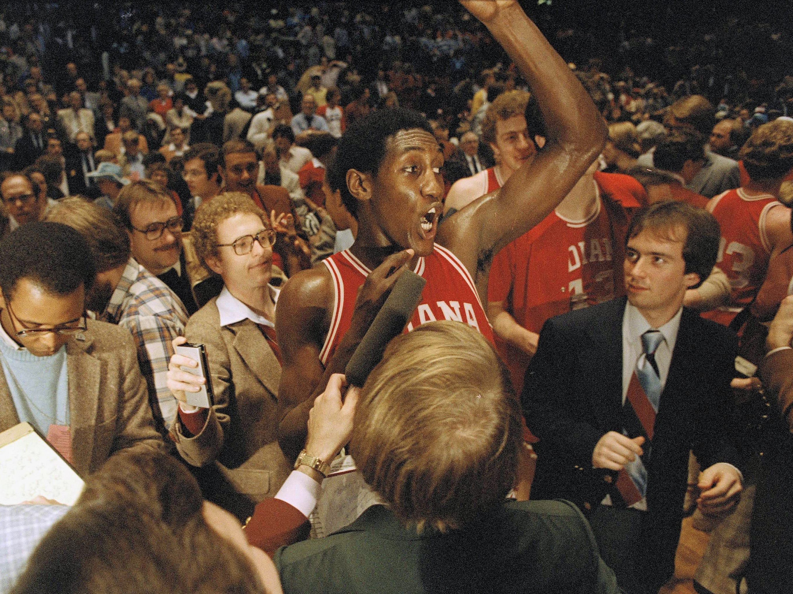 Isiah Thomas of Indiana University is surrounded by newsmen after his team won over North Carolina, 63-50, in the final NCAA championship game, March 31, 1981. Thomas was declared MVP of the game in Philadelphia.