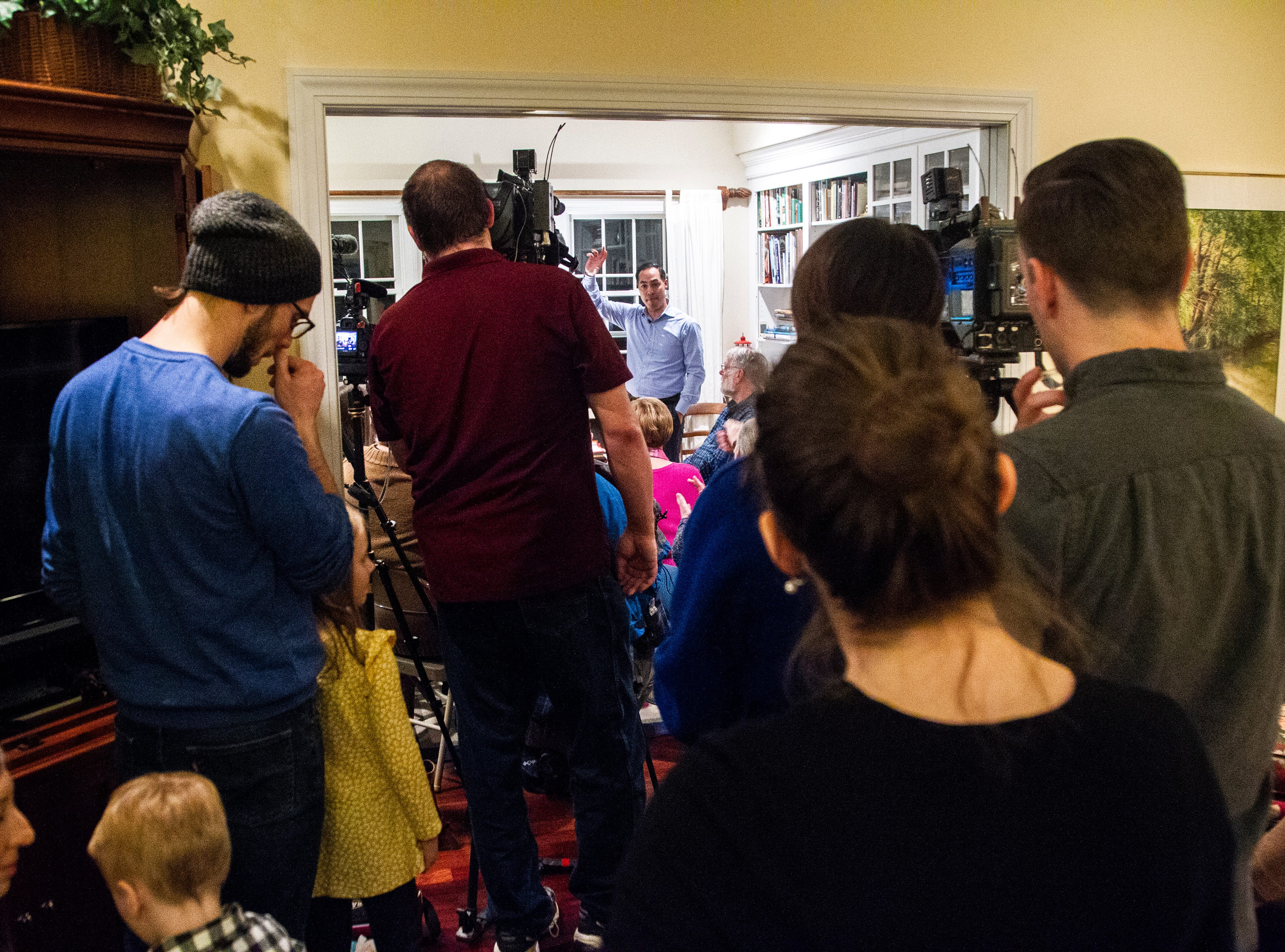 "Julián Castro speaks to supporters and local activists at the Johnson County ""Potluck Insurgency"" on Monday, Jan. 7, 2019, at a home in North Liberty, Iowa. The ""Potluck Insurgency"" is a monthly event held by North Liberty residents Ed and Jane Cranston."